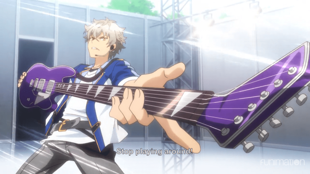 A boy pointing a guitar neck toward the camera. Subtitle: Stop playing around!