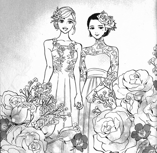 Two women in wedding dresses surrounded by flowers.