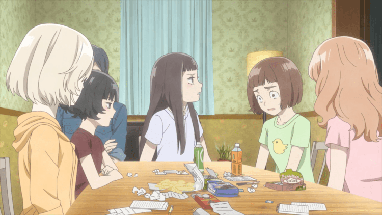 The girls from O Maidens sitting at a table with snacks and paper strewn around; Kazusa looks shell-shocked from an outburst