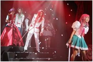 a shot of Utena, Touga, Saionji, and Anthy in the stage adaptation
