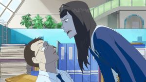 Sayaka from Eizouken looming ominously over a seated, intimidated teacher