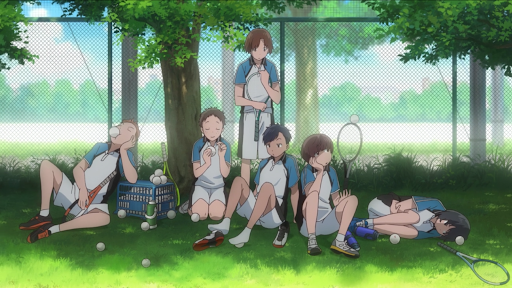 the tennis team sitting under a tree