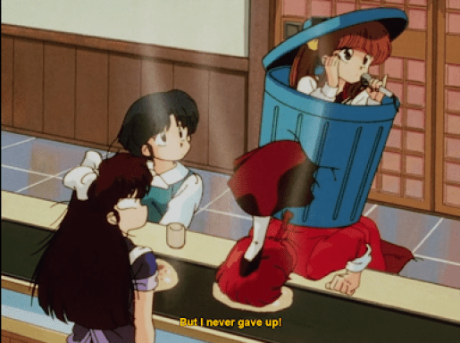 Tsubasa popping out of a trash can dramatically. subtitle: But I never gave up!
