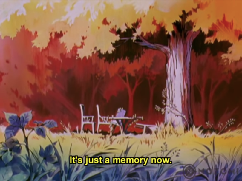 "Two chairs and a table in the grass under a tree. Subtitle text: ""It's just a memory now."""