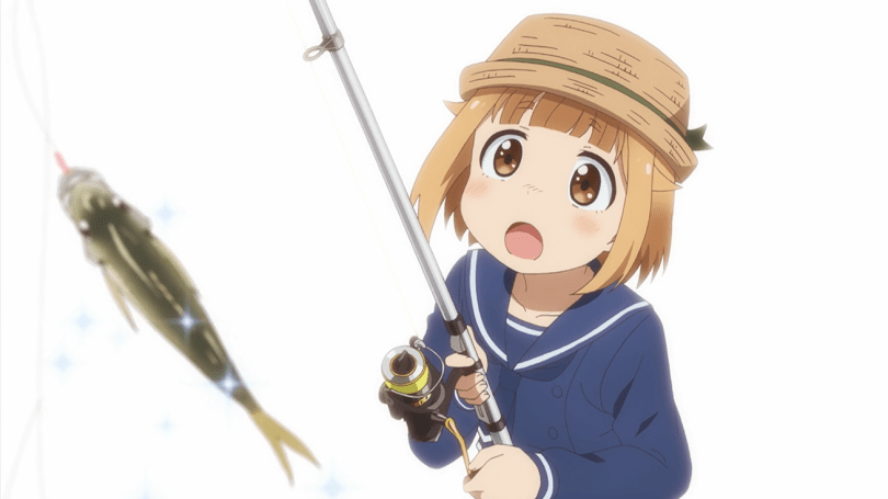 A girl with a fishing rod staring at her catch