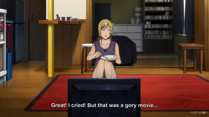 "Minare sitting in front of a TV holding a dish with tears streaming down her cheeks. Subtitle text: ""Great! I cried! But that was a gory movie..."""