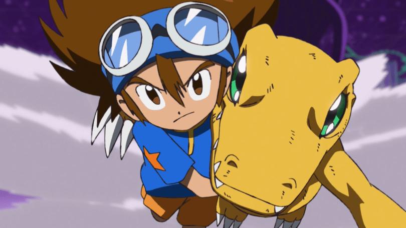 Taichi and Agumon dashing toward the camera