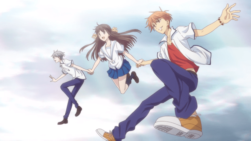 Yuki, Tohru, and Kyo holding hands and smiling as they leap across a blue sky