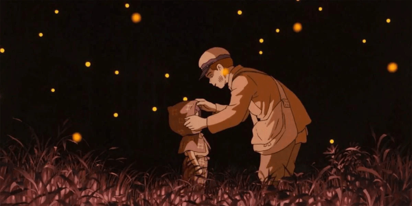 Seita straightening Setsuko's outfit as a ghost, both of them in a red field of fireflies