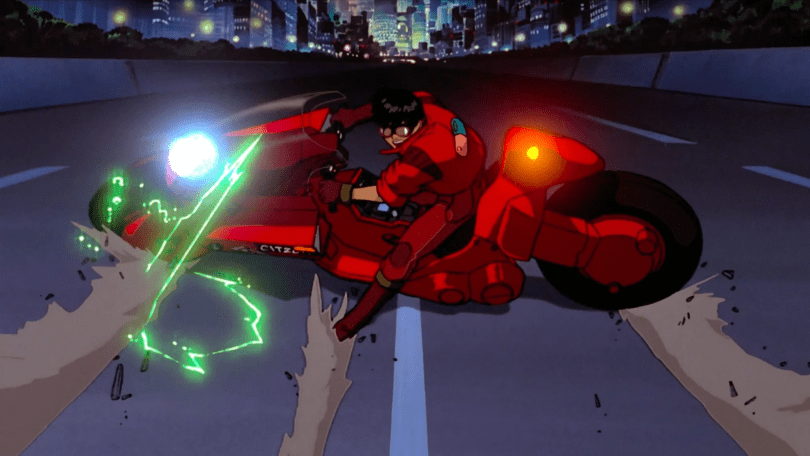 famous image of Kaneda sliding his bike to a stop along the highway