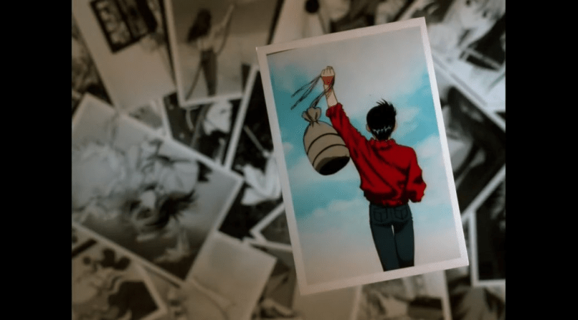 Color photo of Yusuke walking away with a travel bag in one hand, taped up on top of other black and white photos