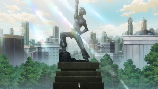 a statue of Kamina pointing upward in a park