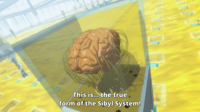 A brain in a glass case amidst a yellow sea of other brain cases. Subtitle: This is... the true form of the Sibyl System!
