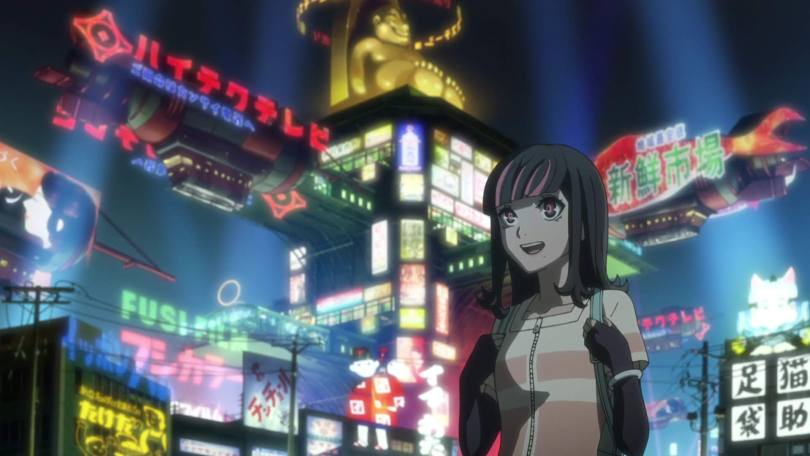 A young woman smiles and stands before a brightly lit city covered in glowing advertisements.