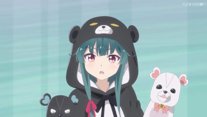 Yuna, the main charcter of Kuma Kuma Kuma Bear, stands in her titular bear costume.