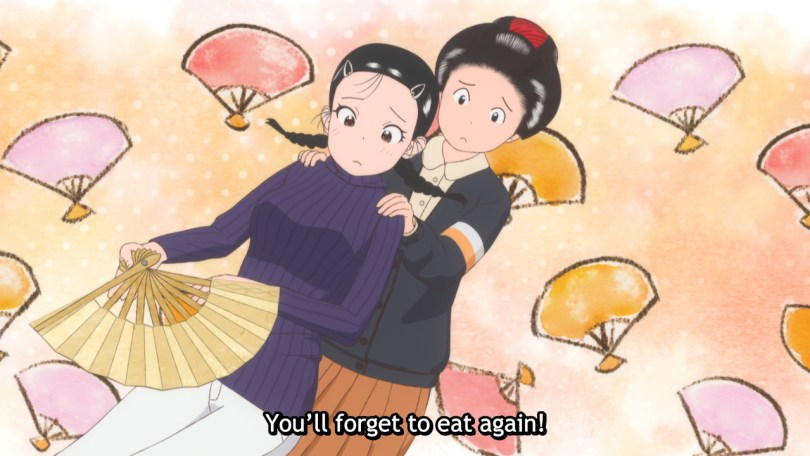 A maiko urges another girl by holding her shoulders. Subtitle: You'll forget to eat again!