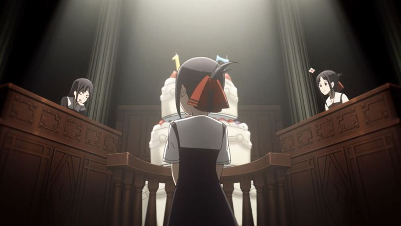 Kaguya on trial before a giant birthday cake, with two other versions of herself arguing prosecution and defense