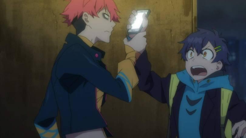 Gauma grabs a startled Yomogi's hand so he can investigate Yomogi's phone.