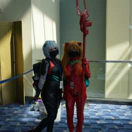 Photo of cosplayers at Otakon 2021 dressed as Rei and Asuka from the Rebuild of Evangelion films