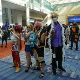 Photo of cosplayers dressed as the leads from Fairy Tail at Otakon 2021