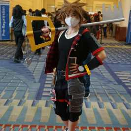 Photo of a cosplayer at Otakon 2021 dressed as Sora from Kingdom Hearts