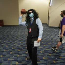 Photo of a cosplayer at Otakon 2021 dressed as Johnny from The Room.