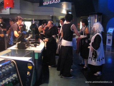 Bleach cosplayers standing in line.