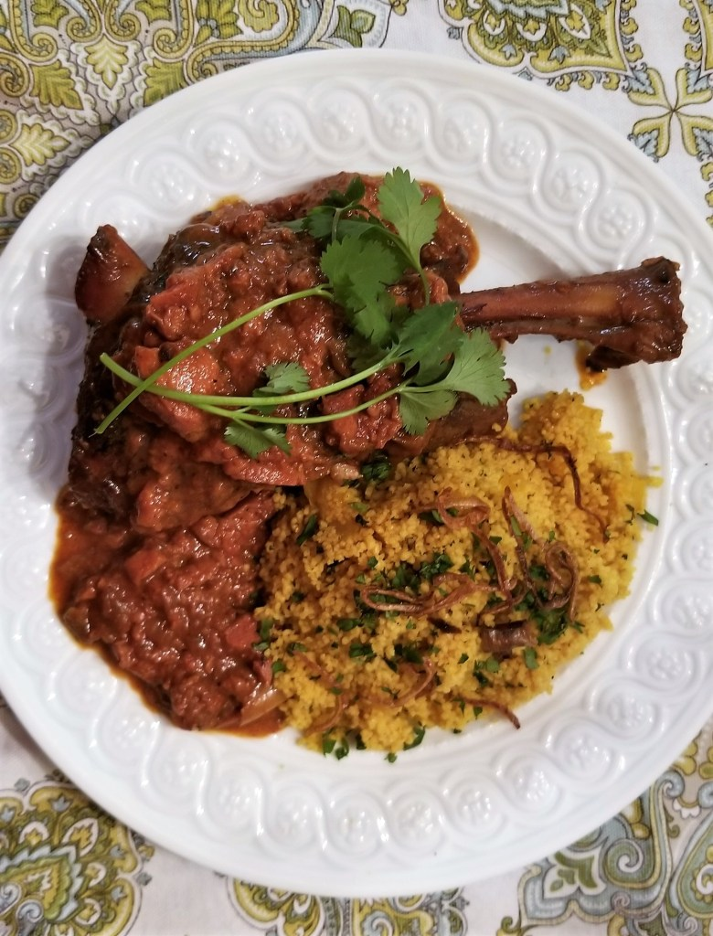 Moroccan Braised Lamb Shanks with Quince Served with Couscous with Apricots, Mint, Cilantro, Parsley and Fried Shallots