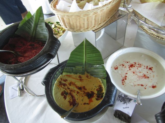 A variety of different chutneys including a beetroot pachadi
