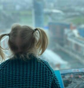 Anita Cleare, parenting expert, @parenting in a time of uncertainty' photo of girl looking over balcony