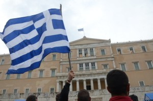 ATHENS, GREECE - 2016/02/12: A flag raise during demonstration against pension reforms in Greece.Farmers from all over Greece demonstrate in Syntagma Square in Athens against the new pension reforms that Greek goverment plans. (Photo by George Panagakis/Pacific Press/LightRocket via Getty Images)