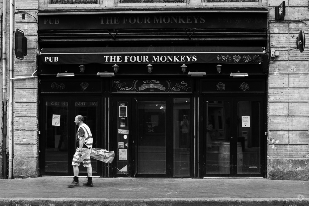Photo sequence on a pub named The Four Monkeys. The sequence shows a working man moving from the right to the left of the frame.