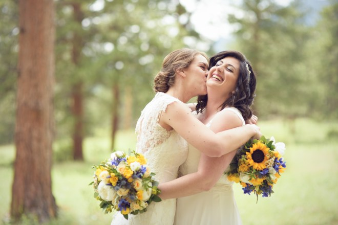 Brides having fun, Sunflower bouquets