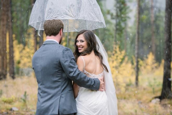 Bride looking back in the rain