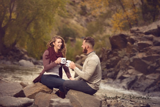 couple drink coffee by the river