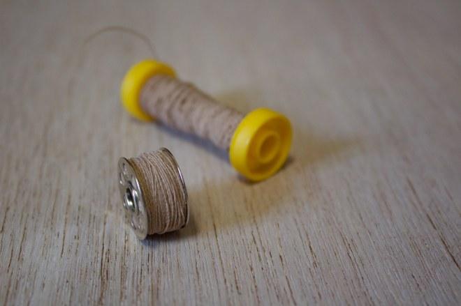 avvolgete il filo elastico alla rondella