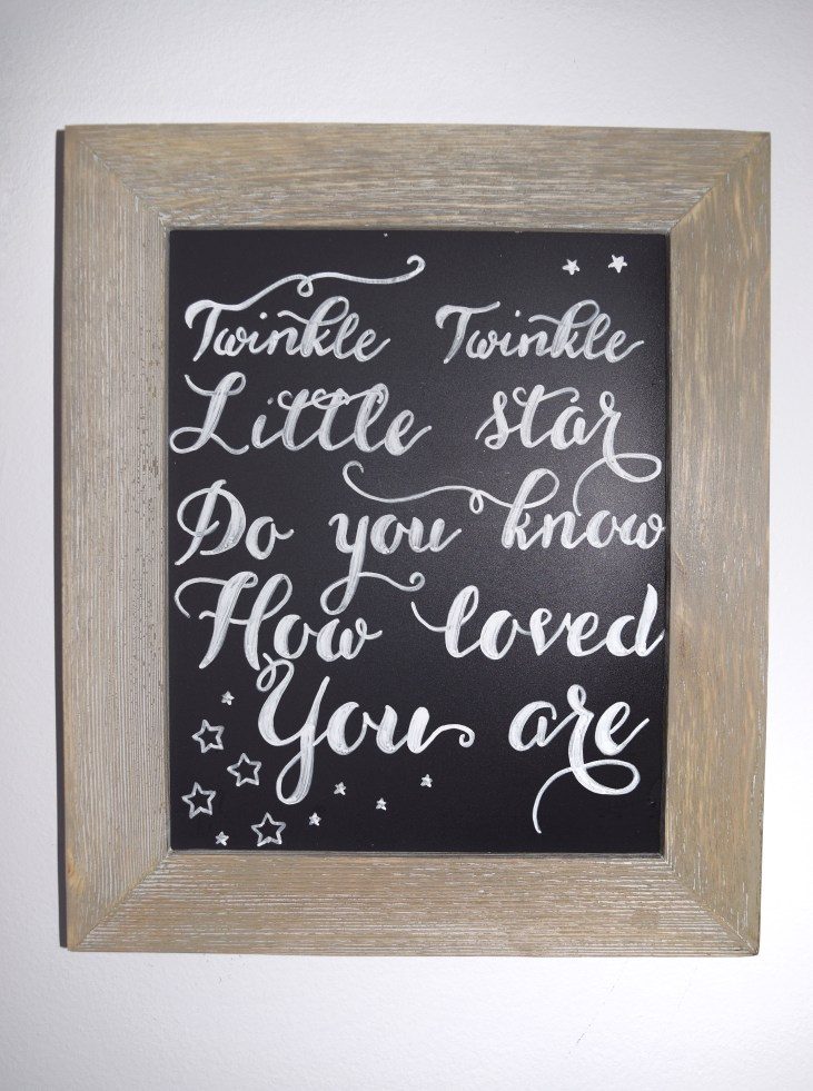 a framed 8 by 10 sized blackboard with the words twinkle twinkle little star do you know how loved you are written on it