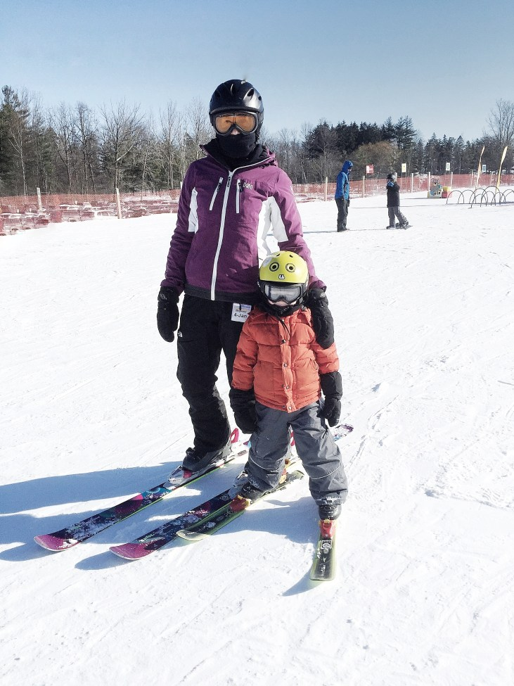 New Year's Resolutions mother and 4 year old son on skiis