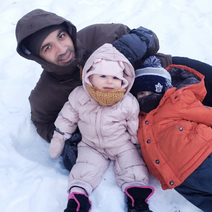 New Year's Resolutions father with two young children in the snow