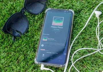 4 Podcasts to Listen While Laying Out in The Sun