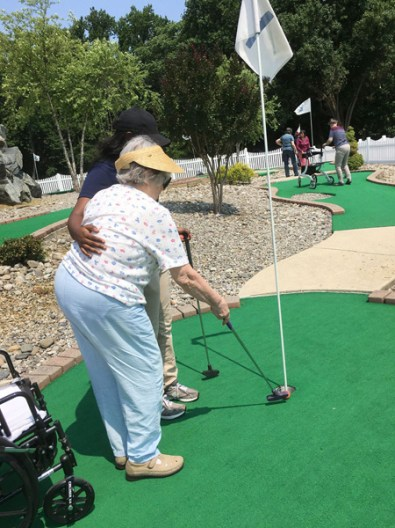 Staff are always here to help, even on the mini-golf course!