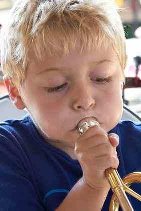A2_MG_1349 Little boy blowing trumpet 2