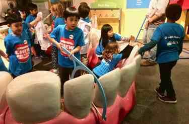 AAHOM Chew on This! Lots of Kids work on teeth