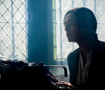 Woman writing on a typewriter