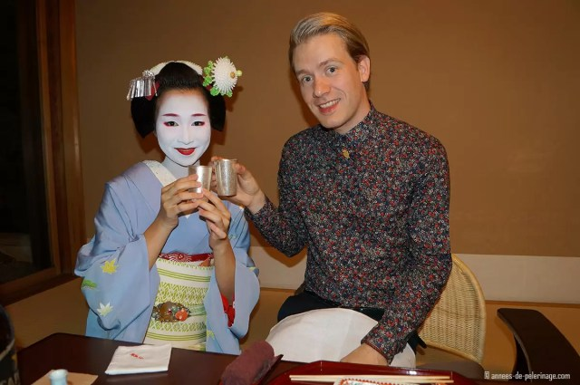 maiko and me saluting with beer tawaraya ryokan