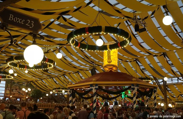 the brass band stage in the middle of a beer tent at oktoberfest