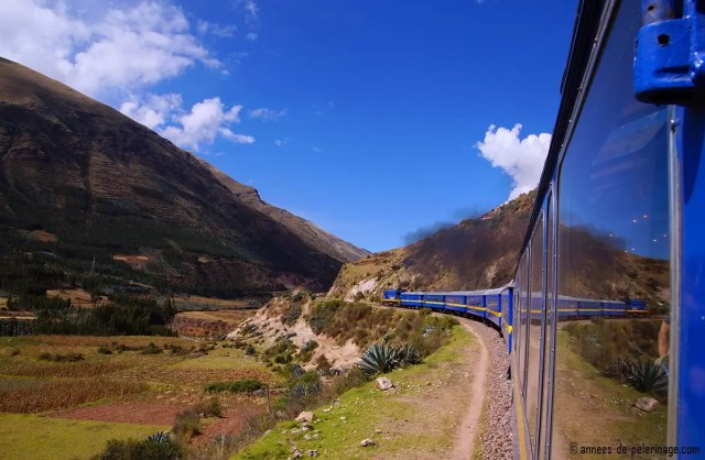 The andean explorer trailing along the mountain side with the beautiful landscape of the altiplano in front of it