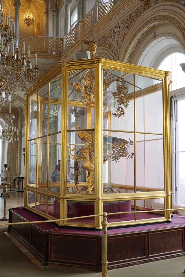 The famous golden peacock clock inside its giant gilded cage in the Hermitage Museum