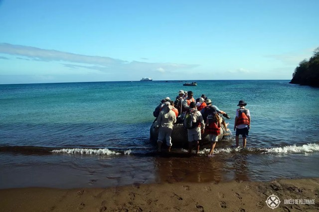 A wet landing on a beach on galapagos - pack clothes that can get wet and dry fast