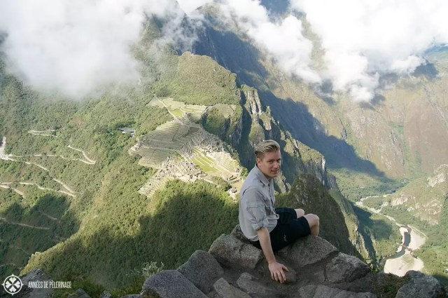 A view to die for: Me sitting on top of Huayna Picchu in Peru with a nice view on the inca ruins of Machu Picchu
